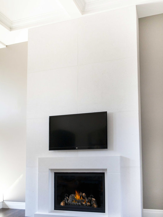 Concrete Fireplace Surrounds - The Berlin Mantel and wall panels designed and handmade by DEKKO Concrete.  This mantel is made of lightweight concrete and designed to fit to any square or rectangular gas fireplace.   Available in 6 colors and available for shipment worldwide.