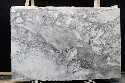 Countertop color super white quartzite or salone granite for How much is a slab of quartz