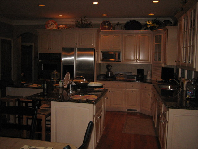 handpainted and distessed black kitchen cabinetry traditional