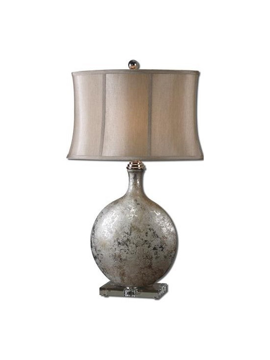 Uttermost Navelli - Metallic silver ceramic base with a gray wash, polished nickel plated accents and a crystal foot. The oval semi-bell shade is a silken champagne bronze fabric.