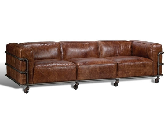 "Sarreid Ltd - Antwerp Couch by BSEID - Not completely retro ... Not completely contemporary ... but, completely cool. Gorgeous veining brown leather is nestled into an iron frame creating an urban chic style. Casters allow ease in mobility. Have fun decorating around this style for a traffic stopping look. Cuba Brown aged metal finish (SAR) 102"" wide x 40"" deep x 28"" high"