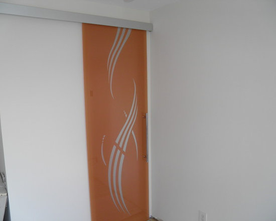 Private residence in Mill Neck, NY (Long Island) - Glass door sliding on wall, orange colored background, frosted decor, aluminum track, designed and crafted in Italy.