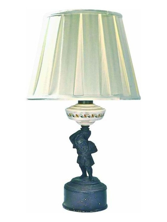 Woodsman/Gnome Lamp - Antique woodsman/gnome lamp depicting a woodsman or gnome carrying a cast iron urn and glass lamp above on his shoulder. Cord is coming out at the bottom of the top brass socket rather then the cast iron base.