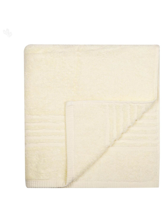 Cream Cotton Bath Towels - Tuck yourself into a creamy soft bath towel that pampers your skin with pure Egyptian cotton and complements your bathroom decor with subtle colours.
