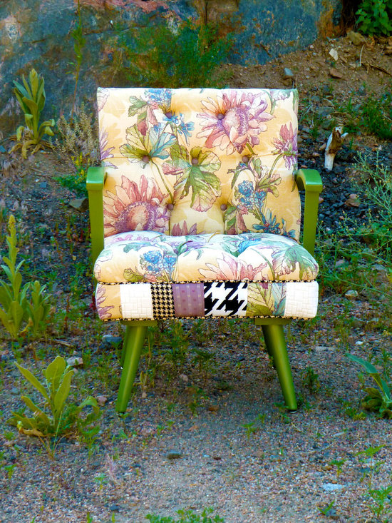 Vintage Furniture Redesigned - This retro chair has a rocking mechanism built into the frame. The inside front is covered ina spirited bohemian vintage floral fabric, and both the retro arms and legs have been painted green to add a pop of color. The entire decking of the seat features a patchwork of funky vintage fabrics, from ivory-and-black houndstooth to a lavender pinstripe. Meanwhile, the back of the chair is covered in a vintage ivory-and-black houndstooth, creating a seat with just the right amount of funk and poise.