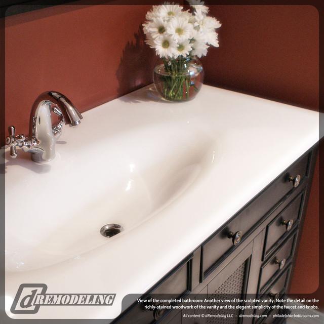 Sleek white sink traditional-bathroom
