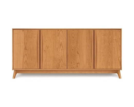 Copeland Furniture - Catalina Cherry Four-Door Buffet | Copeland Furniture - Handcrafted in Vermont by Copeland Furniture.Minimalist style gives the Catalina Cherry Four-Door Buffet clean lines and an elegant presence. The cabinet doors feature sleek integrated wooden bar pulls and soft-close (self closing) door hinges while the cabinet interiors are open with adjustable shelving. Increase this buffet's storage capacity by adding the Optional Cherry Hutch for Catalina Buffets (sold separately). Hand-crafted with impeccable quality and attention to detail, this buffet is bound to last through generations of use and enjoyment. Copeland Furniture uses sustainably harvested hardwoods from the American Northern Forest. All lumber used by Copeland Furniture comes from within 500 miles of their factory in Vermont, thus reducing fossil fuel consumption and carbon dioxide emissions from transportation. The environmental values of preservation and stewardship are reflected in every piece of furniture produced by Copeland Furniture. Product Features:  Adjustable shelving Soft-close door hinges Integrated door pulls run the full length of each door Compatible with the Optional Cherry Hutch for Catalina Buffets Solid cherry wood Made in the U.S.A.