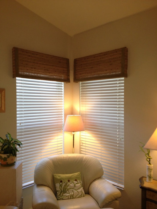 Blinds & Shades - Traditional white fauxwood blinds topped off with woven wood valances enhance this seating area.