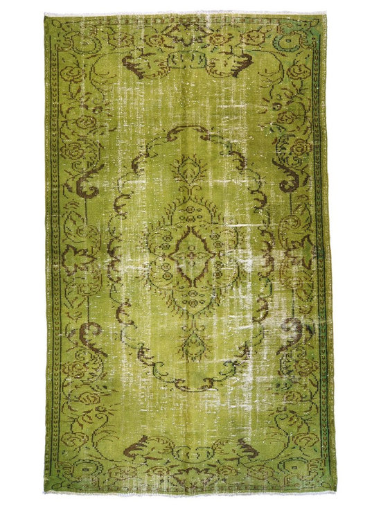 Over-dyed Anatolian Vintage Rug - This piece is an Over-dyed Anatolian Vintage Rug created by first neutralizing the colors and then over-dying with green to achieve a contemporary effect and bring old hand-made rugs back to life. The result is almost like an abstract painting.
