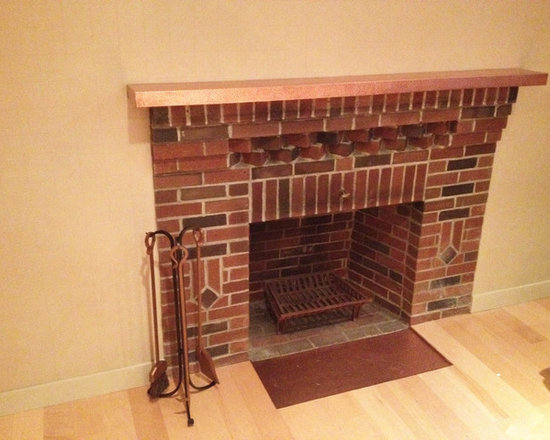 Custom Fireplaces - Fireplace with a hammered copper mantle