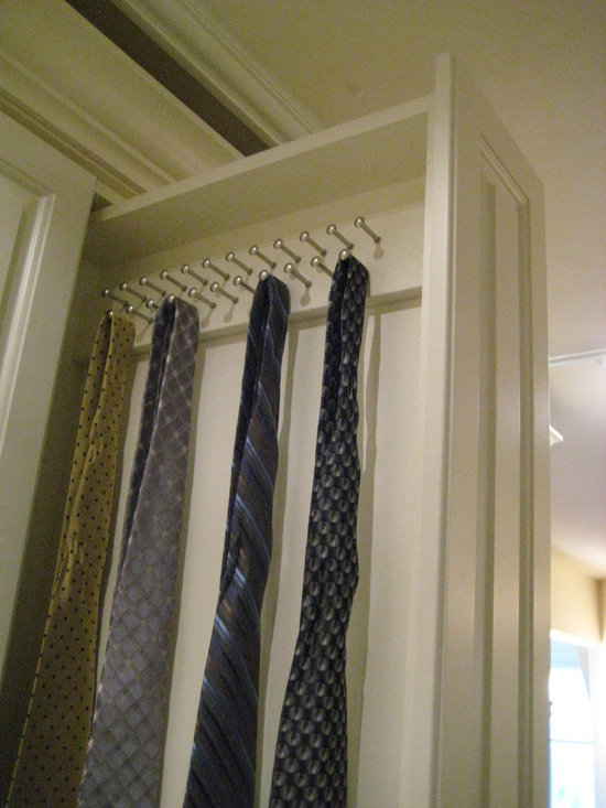 Debbie K/Palos Park - This double sided vertical tie drawer is for the man with lots of ties.  When you put it next to another door the same size, it looks like a cabinet, however, it pulls out like a drawer.