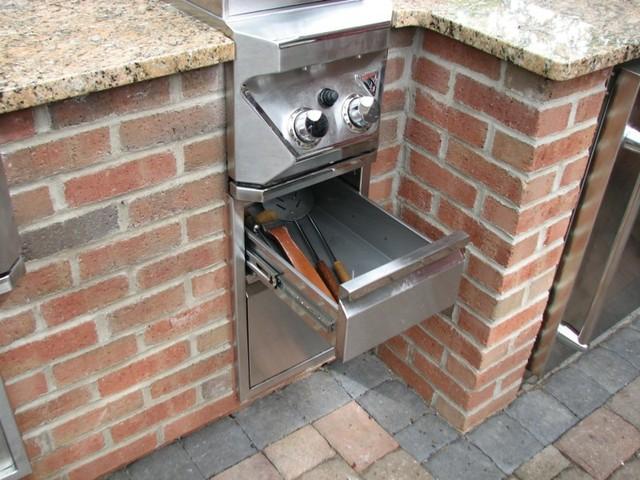 Brick, Granite & Limestone Outdoor Kitchen traditional-patio