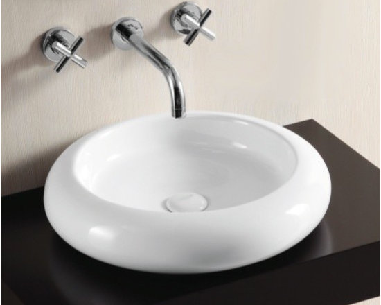 "Caracalla - Shallow Round White Ceramic Vessel Bathroom Sink by Caracalla - This beautiful circular above counter vessel bathroom sink is made of high quality white ceramic. Designed in Italy by Caracalla. Contemporary sink comes with a shallow washbasin, no faucet holes, and no overflow. Sink dimensions: 18.31"" (width), 3.94"" (height), 18.31"" (depth)"