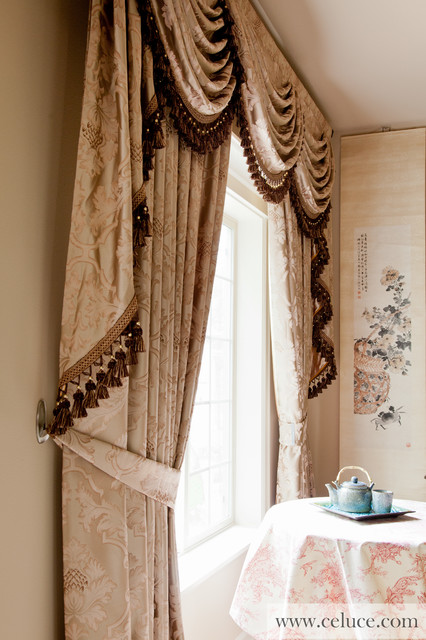 curtains with swags and tails by traditional bedroom