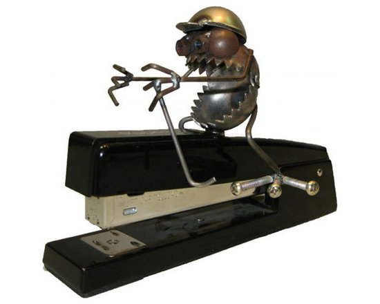 Desk Staple Jockey - Riding the stapler stallion in the desk derby, our magnetic gnarly dude gallops through the next furlong with his trusty crop and riding helmet. The Wing Nut trophy waits at the finish line.