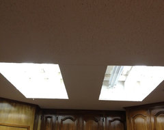 Would like ideas about replacing recessed fluorescent lights in my