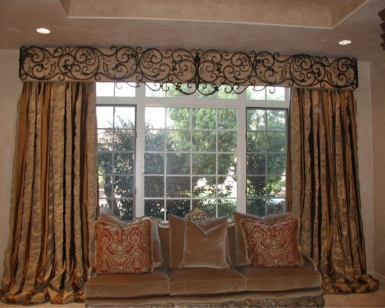 Top Treatments - Upholstered silk taffeta cornice with custom made wrought iron grill work overlay and decadent stationary striped silk side panels mounted beneath cornice.