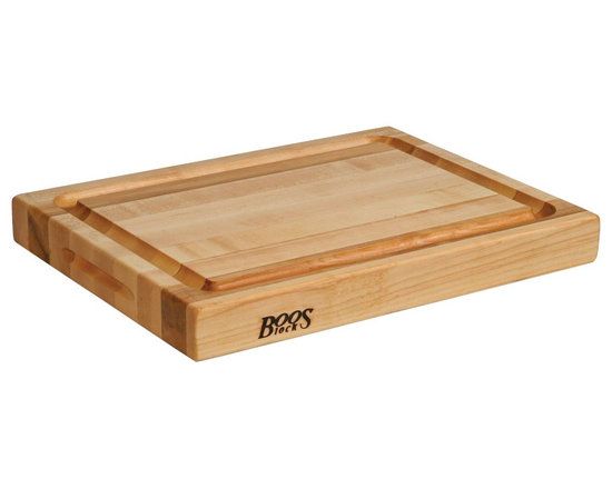 John Boos - John Boos Reversible Edge Grain Cutting Board with Grips - You have visions of perfect soufflés, melt-in-your-mouth roasts and fabulous terrines. Made of 100-percent North American, hard rock maple with grips for easy transportation, this is the cutting board to bring all your culinary dreams to life.