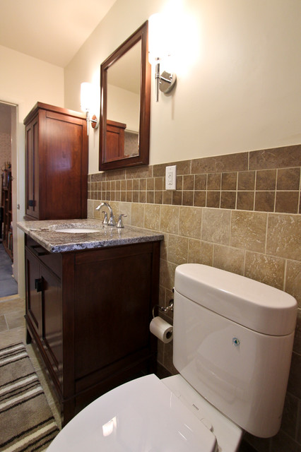 Tan wall tile with brown listelle traditional-bathroom