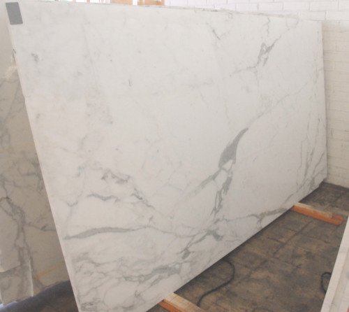 Calacatta Gold Slabs and Tiles traditional-kitchen-countertops