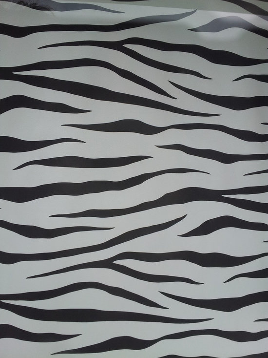 Wallcovering and Paint - A zebra print wallpaper to accentuate your room.