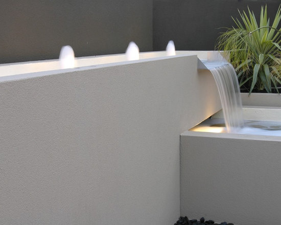 Water Features - Water features designed by H2O Designs are a beautiful addition to any outdoor or indoor space. Using your vision as our inspiration we strive to create innovative, imaginative and practical features using quality materials and exceptional craftsmanship.