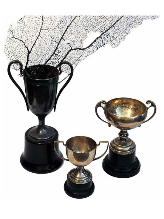 Trophy Set - Three beautiful antique trophies in Art Nouveau and Art Deco style. The tallest trophy is marked by W.M.A Rogers, a family member of the famous master silversmiths.