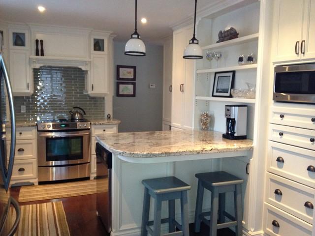 Arctic Cream Granite on Cream Cabinets contemporary kitchen islands