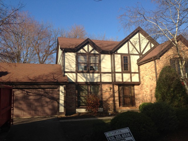 Tudor house with james hardie stucco trim traditional for Tudor siding