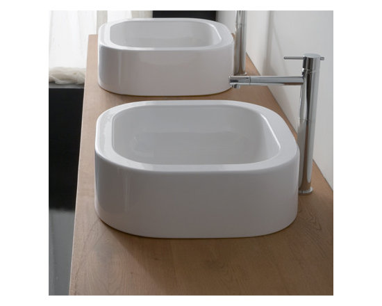 "Scarabeo - Simple and Stylish White Ceramic Curved Vessel Sink - Simple and stylish above counter vessel bathroom sink made of high quality white ceramic. Circular contemporary sink has no faucet holes and comes without overflow. Scarabeo designed and manufactured this sink in Italy. Sink dimensions: 16.00"" (width), 4.30"" (height), 16.00"" (depth)"