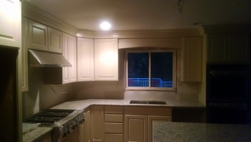 How to match white crown molding with cream cabinet molding??