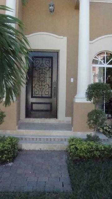 Solid Mahogany Entry Door with Ironwork mediterranean-front-doors