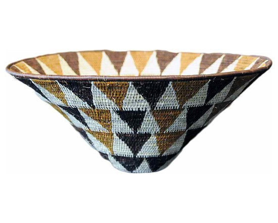 Namibian Basket - The Kavango people in the Northeast of Namibia create these beautiful baskets. They use Makalani palm leaves, grass for the interior of the coils, and all natural vegetable dyes created from locally gathered materials.