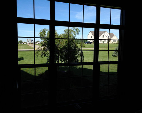 Double Hung Windows - Windows don't have to be large or high in the air to damage your home's interior. We apply window film to regular-old windows every day to help protect our customers furnishings.