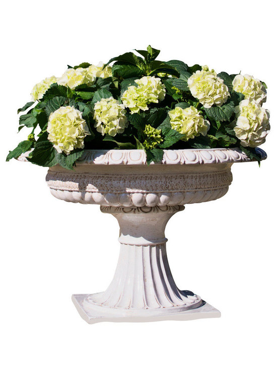 Planter Footed Antique White - Extra Large - A sculptural vessel intended for grand displays brings classical Italian craftsmanship to your home, making the sculptural look of Enlightenment garden heirlooms accessible to you. Elite and richly adorned, the Extra Large Footed Planter in Antique White makes a stunning statement when you mound it with flowers or mass votives in its wide vessel. Use under shelter for longest life.