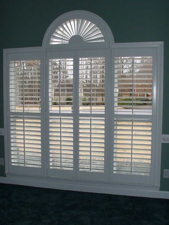 Elite Traditional Plantation Styles - Traditional 3'' Elite Plantation shutters with a sunburst arch featured on the palladium window.