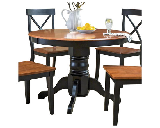 Home Styles - Home Styles Round Pedestal Casual Dining Table in Black and Cottage Oak Finish - Home Styles - Dining Tables - 516830 - The Home Styles Dining Table is constructed of solid hardwood in a multi-step black and cottage oak finish. It features a round shaped wood top and a pedestal base. Suitable for four the transitionally styled Home Styles Dining Table is an ideal central fixture in your dining area or kitchen.