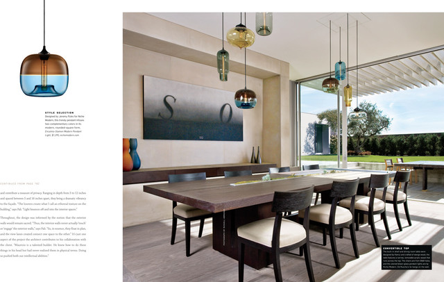 Niche modern lights hanging above a dining room table at for Above dining table lights