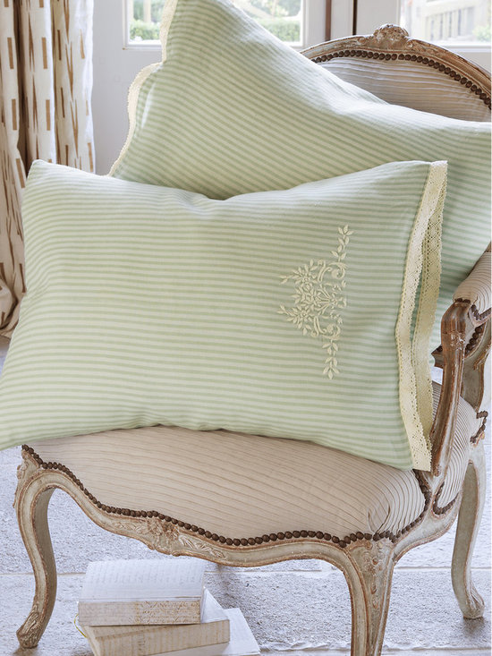 Ticking Stripe Pillowcase Pair - One of our favorite all-time patterns, we adore the relaxed, easy ambiance of ticking stripes on the bed, especially during the warmer months. Cast in serene shades of spa blue and cream, these pretty pillowcases are sewn of enzyme-washed linen for an invitingly soft, wonderfully weathered hand. Delicate cotton crochet lace trim and a sweet floral embroidery accent lend heirloom presence. Pairs beautifully with our Normandy Quilt (#70971). Set of 2.