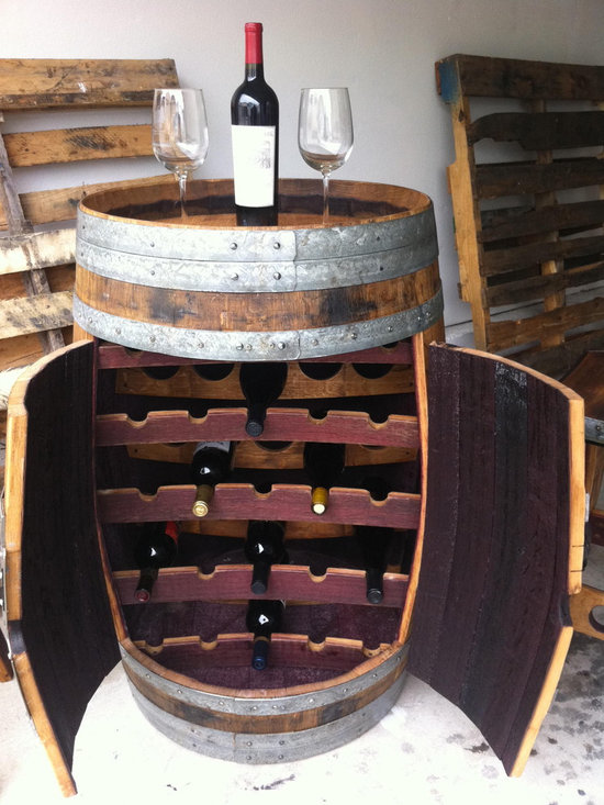 Wine Barrel Wine Rack - This wine rack is handcrafted out of a retired wine barrel sourced from local wineries in the Lodi Appalation.  Hols 25 of your favorite vintages.  Can be used as a tasting table or place a piece of glass on it to creat a large table.