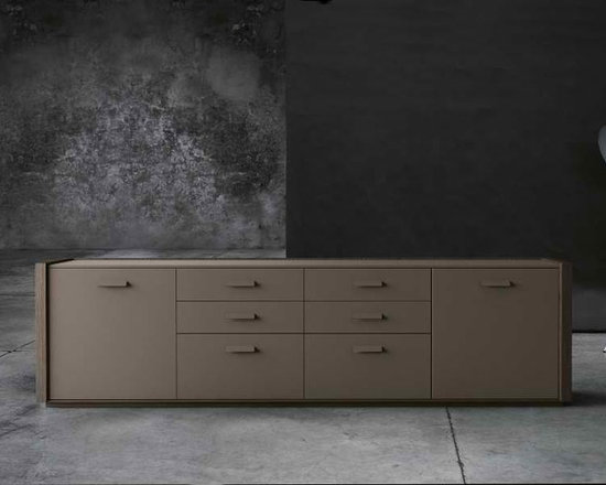 Tratto Low Sideboard - The TRATTO is composed of various cabinets with drawers or shutter doors that can be combined to create tailor-made solutions. This versatile and flexible line of accessories meets all types of needs, thanks to its functionality and pure style, which lets it adapt to all kinds of spaces. The TRATTO system's most sophisticated version has heat-treated oak finishes with hide covered drawers and doors, while for a more contemporary style, customers can choose the glossy or matt lacquered MDF option. The TRATTO system is available in many dimensions so it can be combined in a variety of ways.