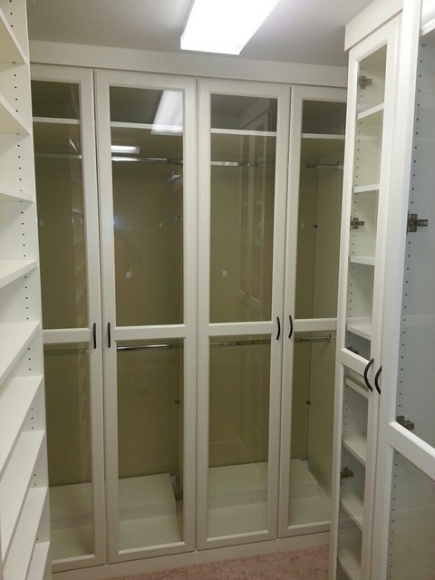 Antique White Melamine with Raised Panel Doors & Glass Inserts transitional-closet