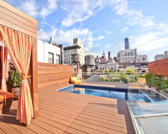 Endless Pools - Original Endless Pools®, Rooftop Swimming Pool - Limited on space?  Try a rooftop installation!  This Endless Pool opens to a spectacular NYC view. The modern lines of the cherry-toned deck, container garden, and vibrant cabana complete this lofted urban getaway.
