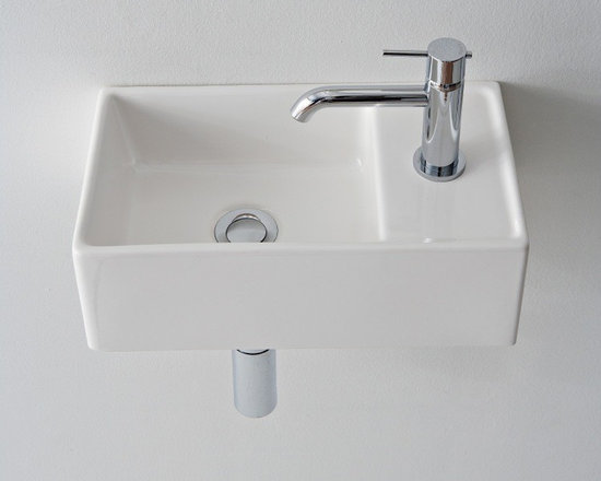 "Scarabeo - Compact Square Ceramic Vessel or Wall Mounted Bathroom Sink - This small modern style square white ceramic sink is made in Italy by Scarabeo. Sink can be installed as either a wall mounted or above counter vessel sink. It includes overflow and a single faucet hole. Sink dimensions: 16.10"" (width), 5.50"" (height), 9.10"" (depth)"