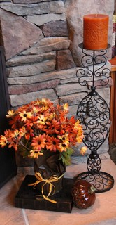 autumn flowers paired with a pumpkin spicd candle