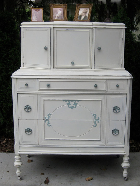 """Hand Painted Vintage Dressers - What a beauty! Victorian High Boy, shabby chic'd in Annie Sloan's """"Old White"""" Chalk Paint with Provence (blue) accents. Original brass handles are rubbed with Provence Blue as well. This dresser holds a lot! Two very large drawers on bottom, and three smaller drawers on top. Three deep cupboards on top of dresser, the middle one opens up with a mirror."""