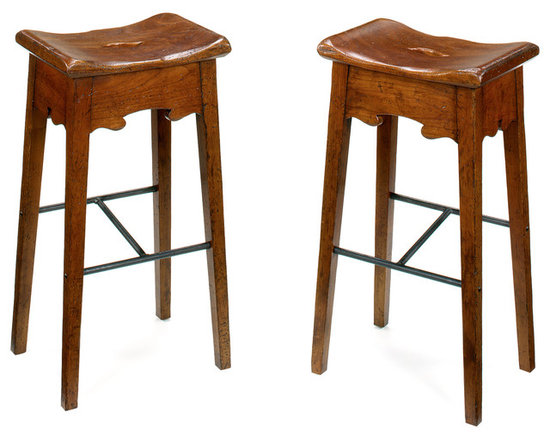 The No. 119 Bar Stool - We designed these Tuscan stools for Jim Noble's Rooster's Wood-fired Kitchen in Charlotte. The seat is very comfortable with well-rounded edges. Note that the footrest on one side is higher than on the other side to accommodate tall and short people.