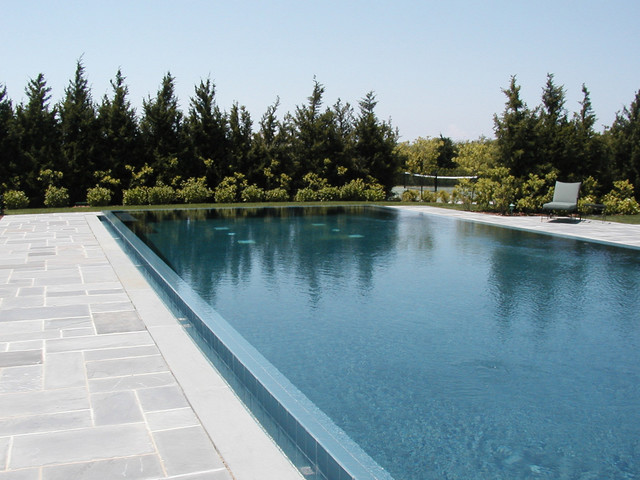 Infinity edge negative edge rimless pools traditional for Pool negative edge design