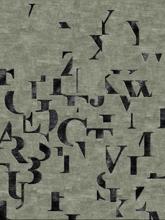 The Times Rug in Gray - Times Gray is inspired by the Times New Roman font and the letters of the alphabet. The twenty-six characters, rendered in silk, are artfully scattered across a solid field.