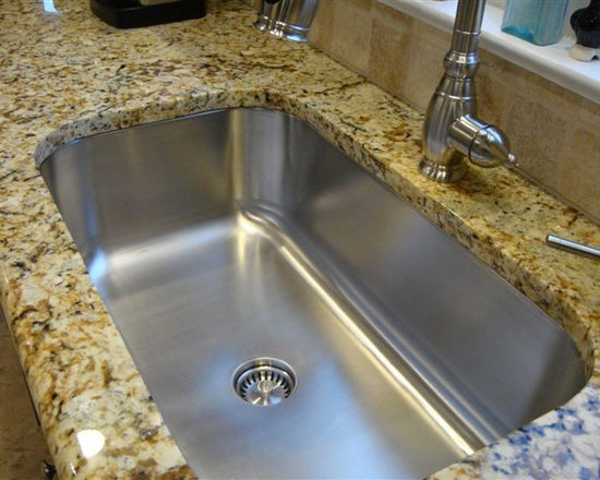Seamless Sink in granite kitchen setting large single bowl - UltraClean Undermount Kitchen Sinks  by Create Good have a seamless, perfectly formed drain. This UltraClean Single Bowl kitchen Sink is perfect for families desiring the highest sanitary standards all the way to the drain.